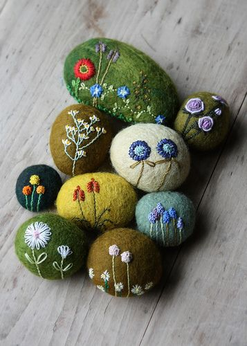 My quest for spring continues.  Flowers embroidered on wool-covered stones.