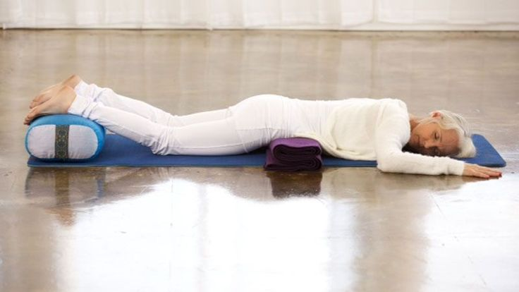 Woman demonstrating downward-facing rest posture.