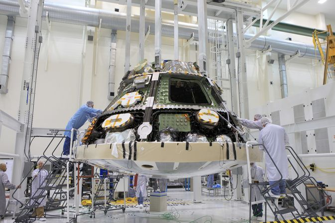 Engineers completed installing the heat shield on NASA's Orion spacecraft ahead of its first trip to space in December. The flight test will send an uncrewed Orion 3,600 miles into space before returning it to Earth for the splashdown in the Pacific Ocean. The heat shield will help protect the Orion crew vehicle from temperatures of about 4,000 degrees Fahrenheit during its reentry into Earth's atmosphere.