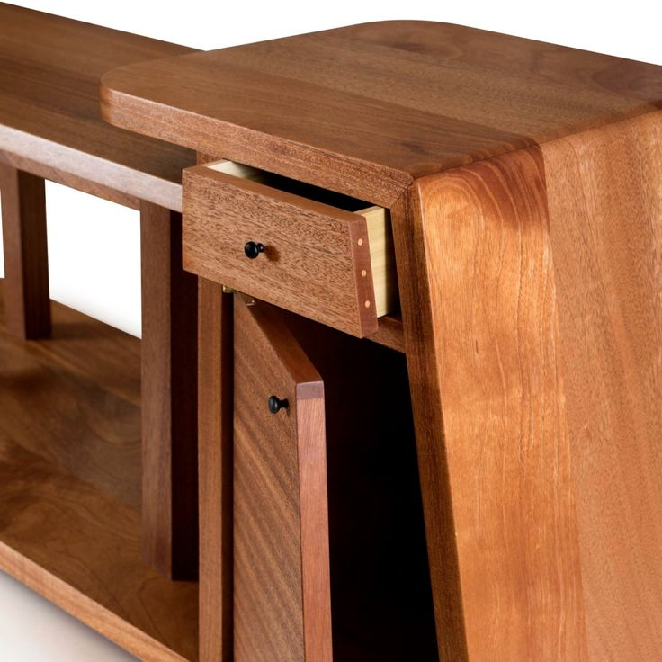 Mahogany coffee table from earlier this year. Love the way this one turned out.  It got sent out to Detroit last month! #woodworking #woodwork #furniture #furnituremaker #designer #coffeetable #table #mahogany #drawer #beer #dwell