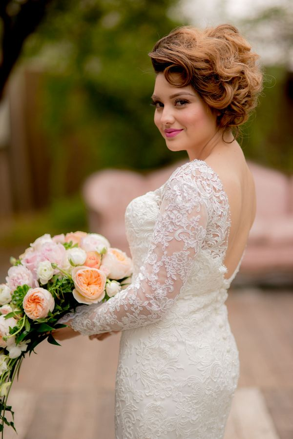 This bride's long-sleeved wedding dress is entirely stunning! | http://adornmagazine.com | Elmer Escobar Photography