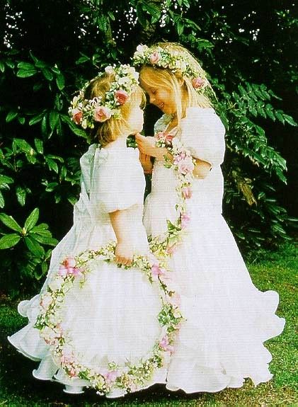 yoursweetremedy:  Young Princess Beatrice, age 4, and Princess Eugenie, age 3, carry floral wreaths as bridesmaids at the wedding of their nanny Alison Wardley. April 24, 1993 Withington, Manchester, England, UK