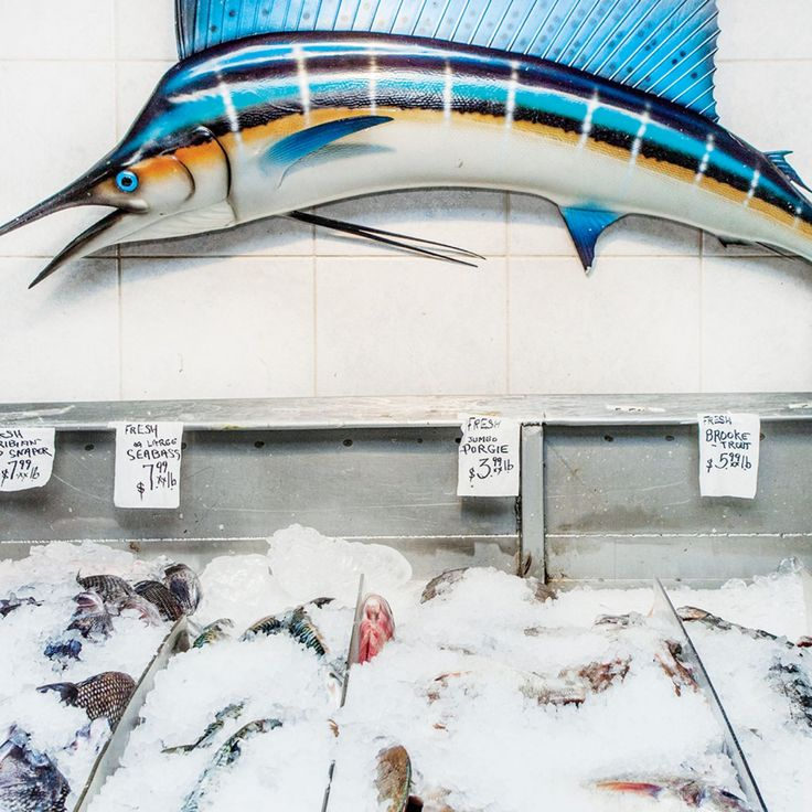"""Astoria Seafood: """"People of all ages, ethnicities, and economic brackets are drawn by a powerful common denominator: fresh fish, prepared simply and sold at a fraction of what it costs almost anywhere else."""" http://nyr.kr/1F0j8ix (Photograph by Lauren Lancaster.)"""