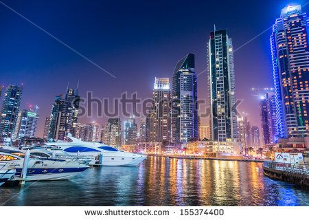 DUBAI, UAE - NOVEMBER 13: Dubai downtown night scene with city lights, luxury new high tech town in middle East. Dubai Marina cityscape,  on November 13, 2012 in Dubai, UAE. - stock photo