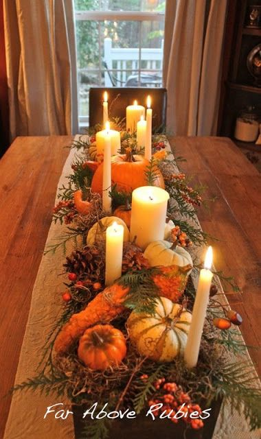 Evergreen sprigs and white candles of varying sizes are the backbone of this autumn tablescape. For an easy winter update,  remove the gourds and add pinecones, berries, and red fruit.  Learn more at Far Above Rubies.    - CountryLiving.com