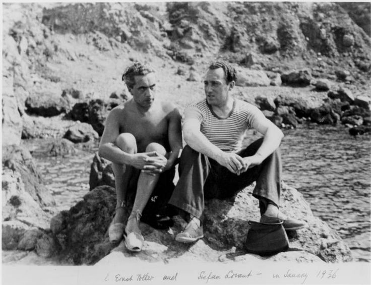 Lion Feuchtwanger Papers, 1884-1958 - L. Ernst Toller and Stefan Lorant sitting together on the rocky shores of Sanary, France in 1936.