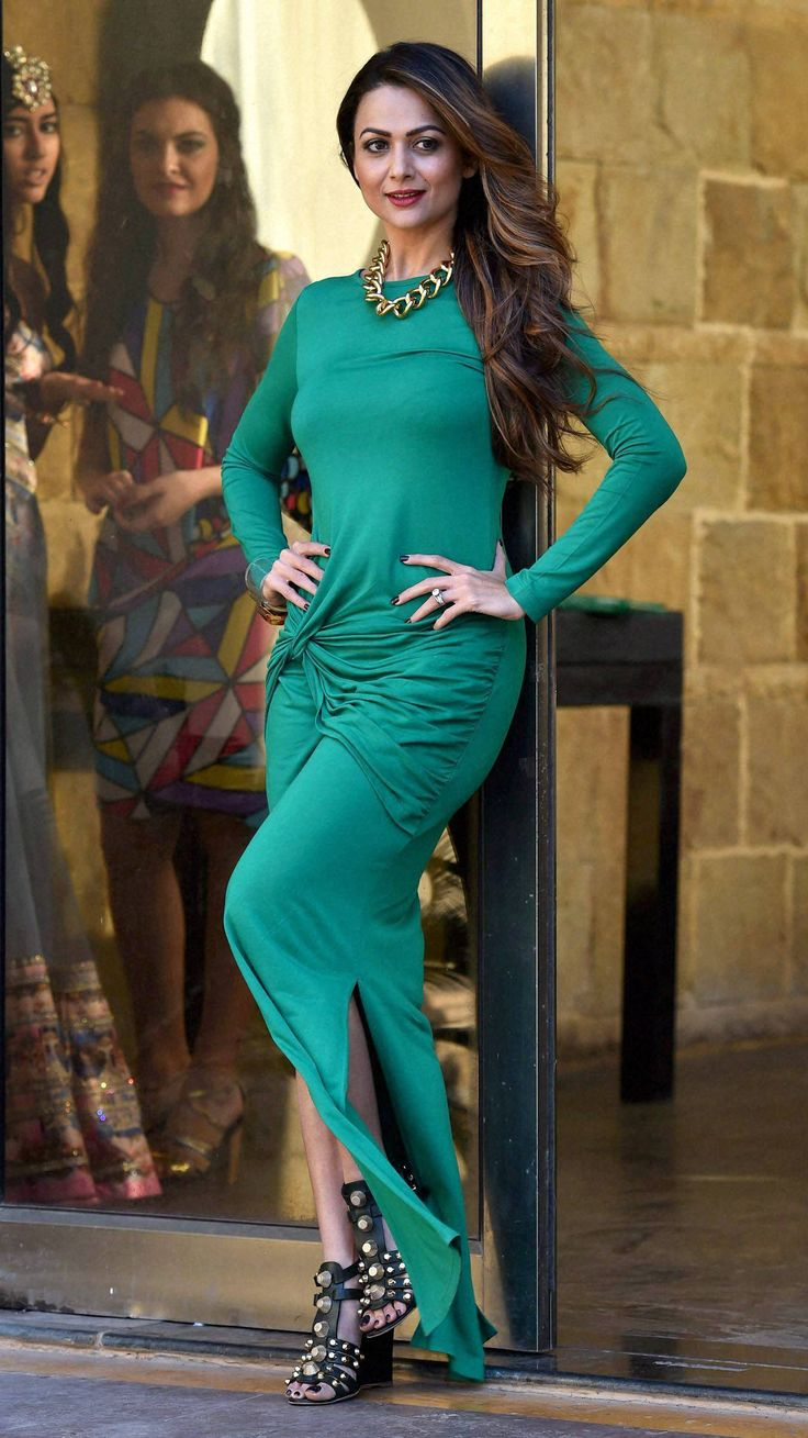 Bollywood actress Amrita Arora poses for media in Mumbai on Wednesday during a press conference of India Beach Fashion Week Goa.