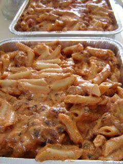 Easy Baked Ziti: 1 16 oz. box mostaccioli or penne noodles, 1 jar spaghetti sauce ,  1 pound italian sausage ,  1 16 oz. container ricotta cheese ,  1/2 c. sour cream ,  2 c. shredded mozzarella