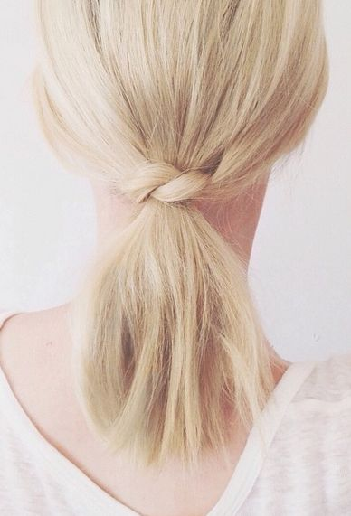 a simple twist and a low ponytail