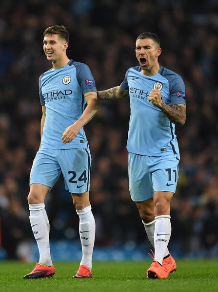 John Stones of Manchester City (L) and Aleksander Kolorov of Manchester City (R) celebrate their win after the final whistle during the UEFA Champions League Group C match between Manchester City FC and FC Barcelona at Etihad Stadium on November 1, 2016 in Manchester, England.