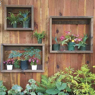 Box Small Plants    Make a big impact with small plants by grouping them together inside wall-mounted shadow boxes made from weathered wood scraps. Cut the boards to the desired length, nail them together (no fancy mitered corners required), and hang on your fence or garden wall.: Plants Can, Gardens Ideas, Gardens Fence, Fence Ideas, Shadowbox, Frames, Shelves, Shadows Boxes, Planters Boxes
