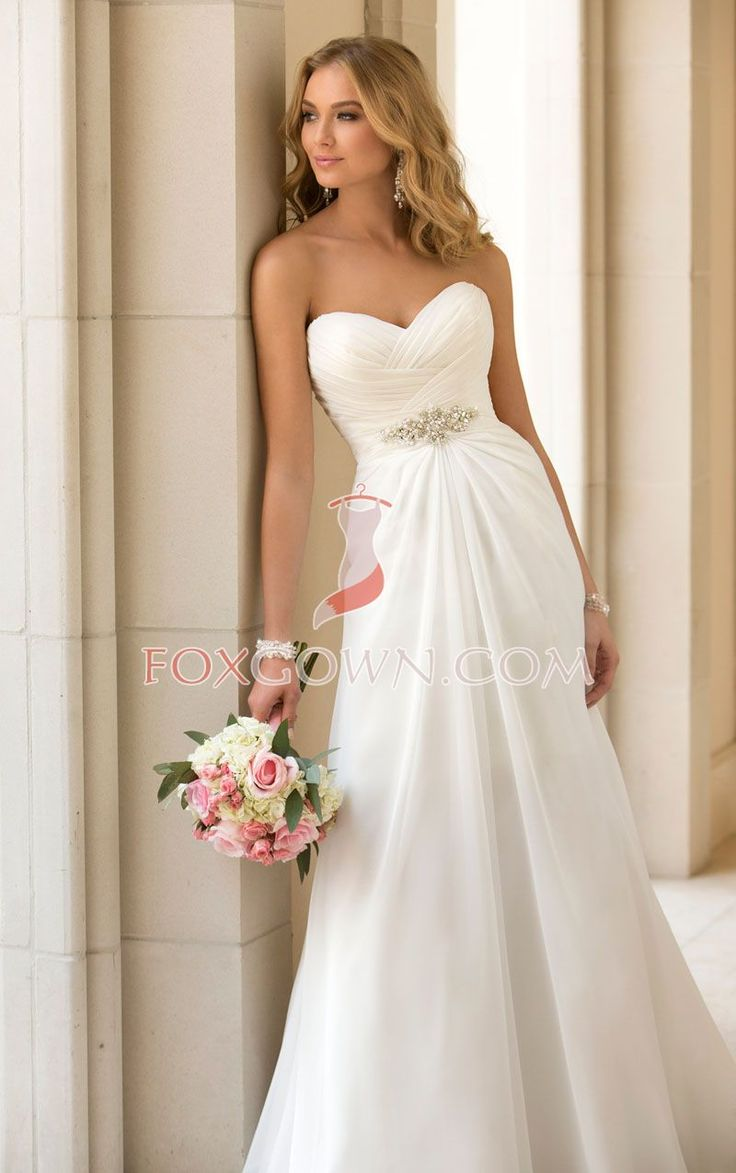Inspired from hollywood designer, this simple yet stunning slim A-line chiffon wedding dress will be a top trend in this season, the figure flattering criss-cross ruching along the strapless sweetheart bodice, under busts crystal beaded brooch draws attention, the skirt flows to the floor with sweep train.