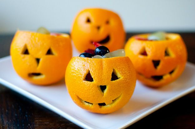 Orange Snack-O-Lanterns | Here's a cute Halloween craft you can do with the kids. #DiyReady diyready.com