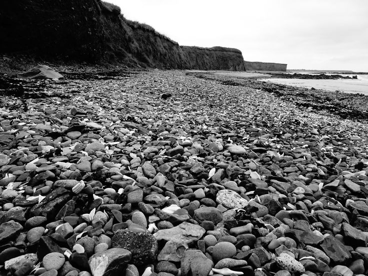 Pebbles and cliffs
