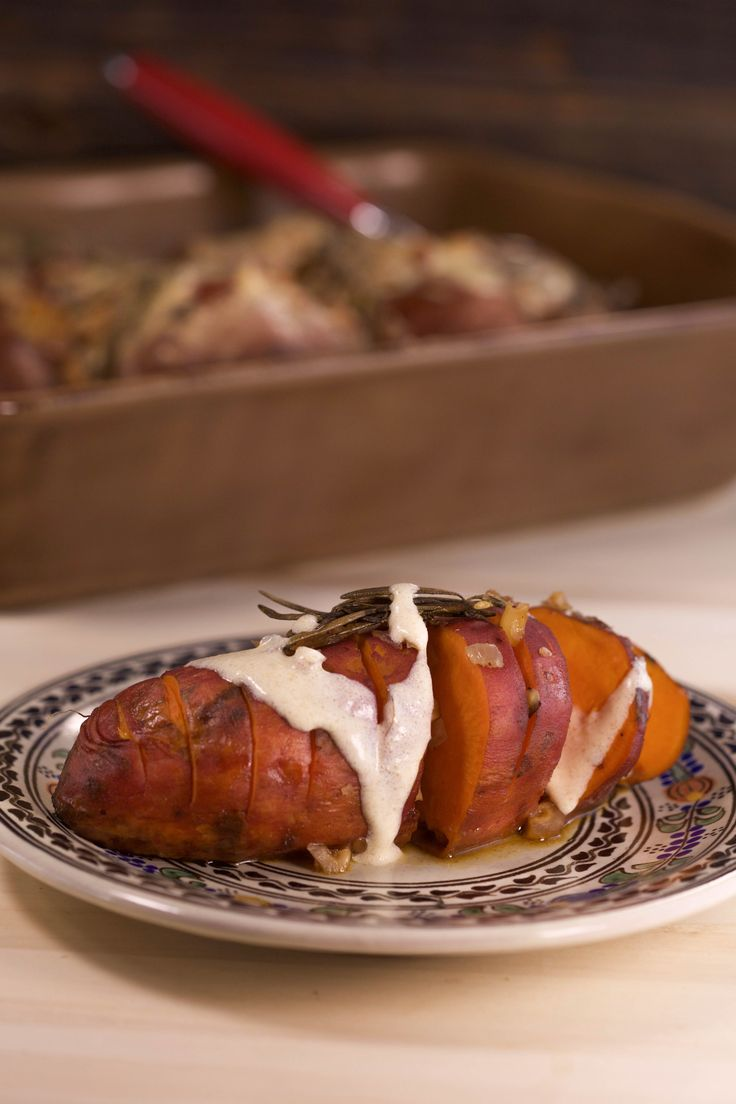 Looking for a new way to serve sweet potatoes this Thanksgiving? How about baked with chopped hazelnuts, Frangelico liqueur, rosemary and a spiced mascarpone topping?!