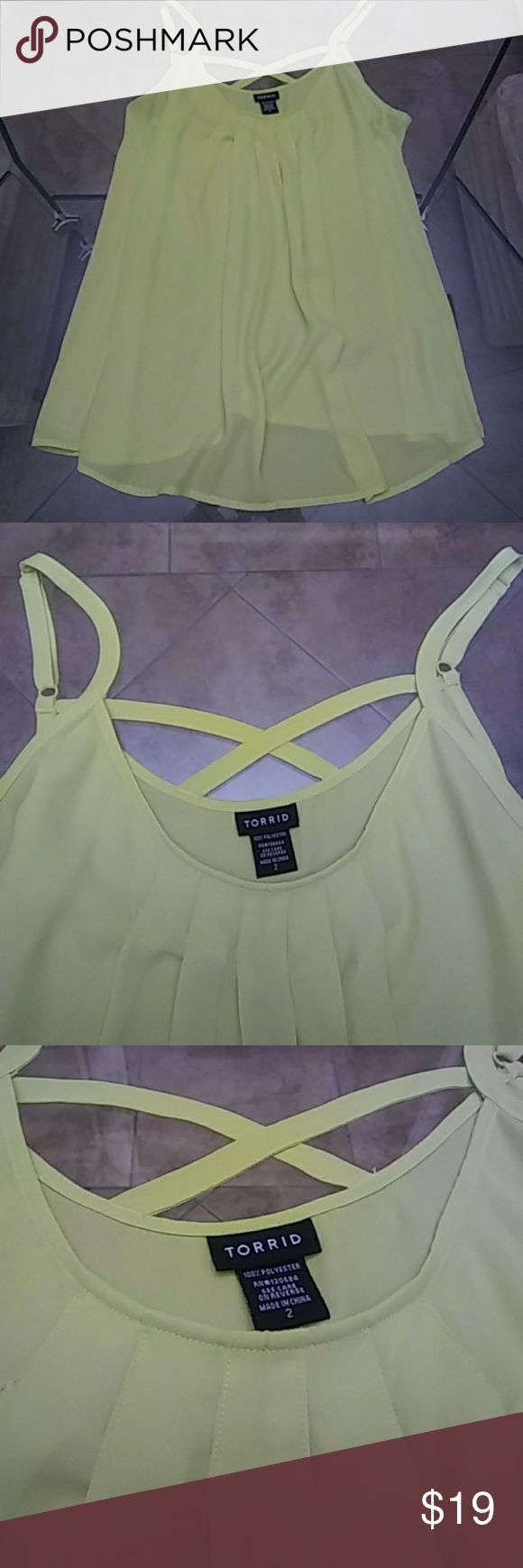 TORRID Flowy Cami NWOT - Really pretty top! Neon color. Never worn. Cute criss cross straps on the back. Smoke free home. torrid Tops Camisoles