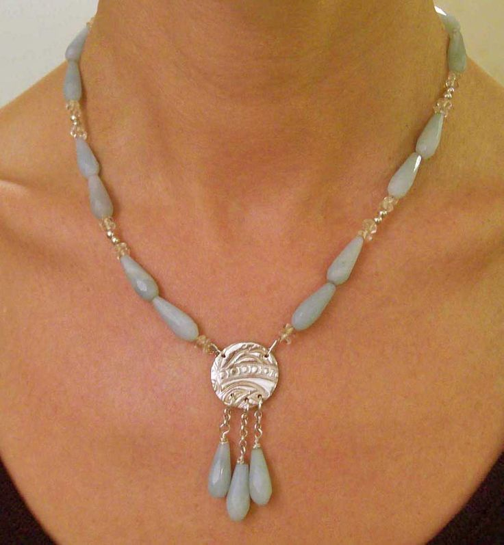 Designed and made by Nuit Nuit Ammonite with a pure silver (.999) centre disc