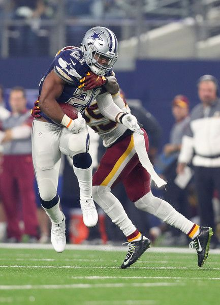 Ezekiel Elliott Photos Photos - Ezekiel Elliott #21 of the Dallas Cowboys carries the ball during the fourth quarter against the Washington Redskins at AT&T Stadium on November 24, 2016 in Arlington, Texas. - Washington Redskins v Dallas Cowboys