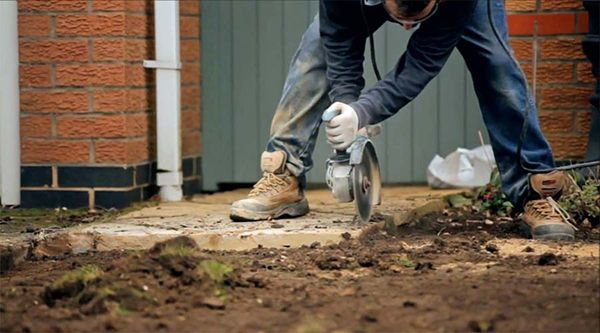 Use a disk cutter to trim any mortar haunching flush with the paving, creating a neat edge for the turf to run into and be fixed in place.