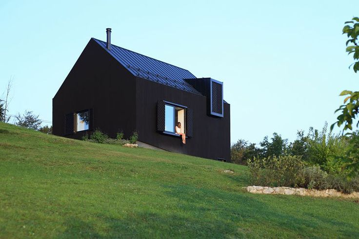 This small modern black house sits on a slope in the countryside of Croatia. Needs more glass but its a beautiful design