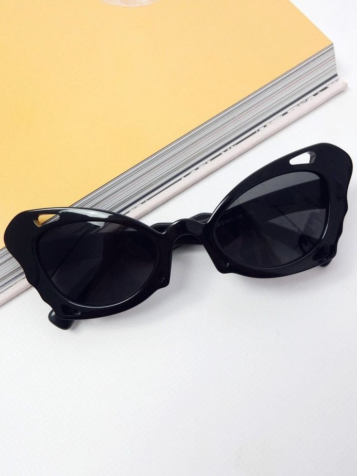 NEW black sunglasses. Brand / Bamona. Cat eye/butterfly shape. Black plastic frame. Black tinted lens. Acetate/polycarbonate. Lens width / 7cm. Lens height / 5cm.