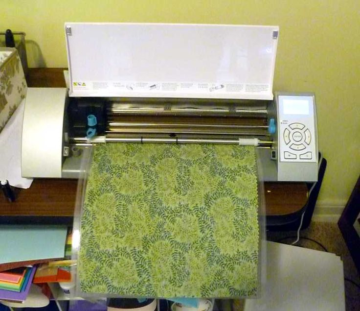 Load mat into machine