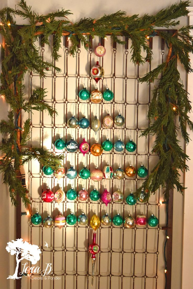 So clever! Hang vintage ornaments on an old mattress spring.