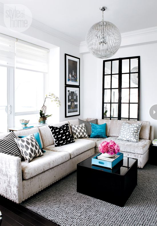 Pops of colour in a black and white room