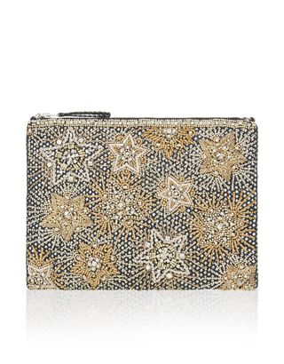 With more stars than the night sky, this pretty handbag is perfect for a night out. Covered all-over in beading, embroidery and sparkling gems, it has a secure zip top and a delicate metal chain strap so that you can enjoy your evening hands-free.