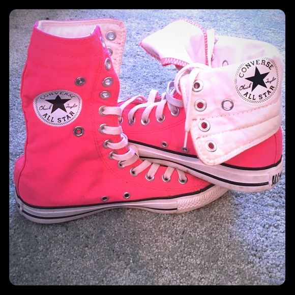 Hot Pink High top Converse Worn converse. Still a lot of use left in them! Hot pink and able to wear up or folded down. Slight dirt stain on one side but could possibly come out. Converse Shoes Sneakers