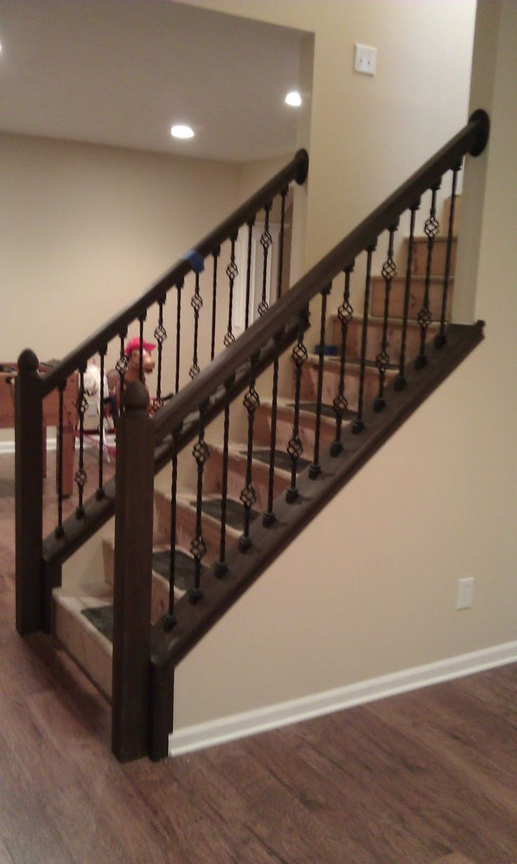 banister newel with rod iron | Black Wrought Iron Baluster And Dark Brown Oak Wood Handrail And Newel ...