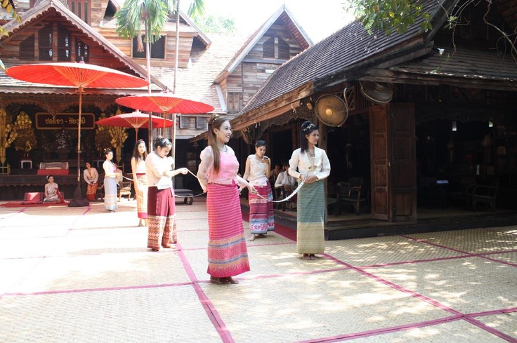 Thai girls dressed in Lanna style during a traditional wedding ceremony in Chiang Mai