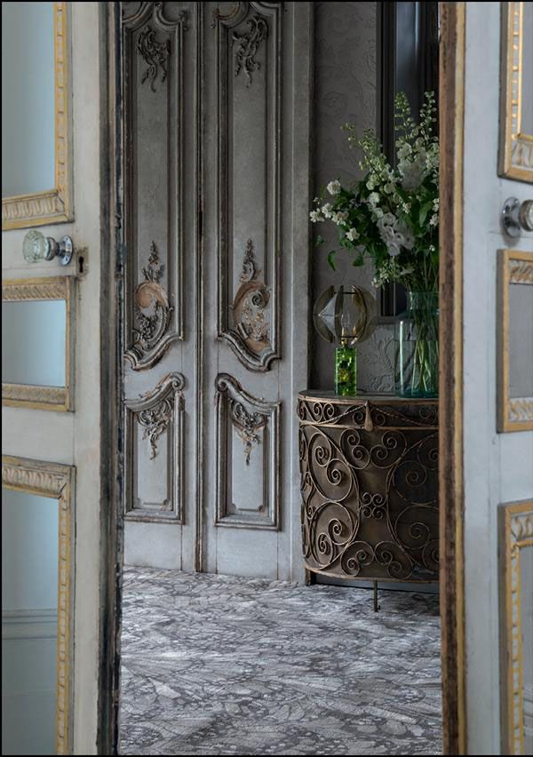 Old doors with distressed grey tones, love the french millwork. Rug is from the Rug Company