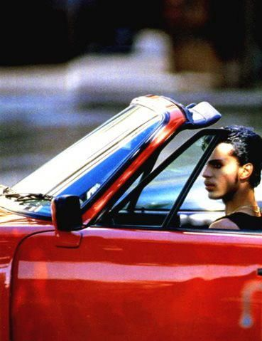 Filming Under The Cherry Moon in the red PORSCHE convertible seen in the shopping scenes in the movie!
