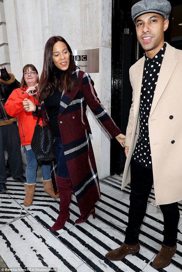 Chic: The former Xtra Factor presenter wrapped up against the cool November chill in a maroon woven checkered coat, which she matched with suede thigh-high boots