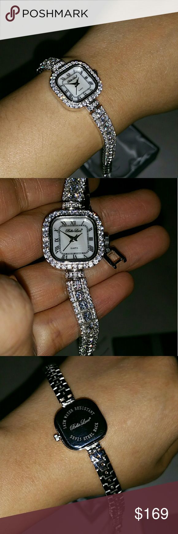 """BELLA LUCE 10.70 CTW ROUND WHITE DIAMOND SIMULANT. Bella Luce? Ladies 10.70ctw Round Sterling Silver Watch  JTV Price: $179.99    Bella Luce? Ladies, White Diamond Simulant 10. 70ctw Round, White Mother Of Pearl Dial, Rhodium Plated Sterling Silver Watch. Measures Approximately 7 & 1/2""""l X 1 & 1/8""""w With A Foldover Clasp Closure. Features A Sterling Silver Case Back, Quartz Movement, A Push/Pull Crown, And Is Water Resistant Up To 3 Atm.  From the Italian words meaning """"beautiful light""""…"""