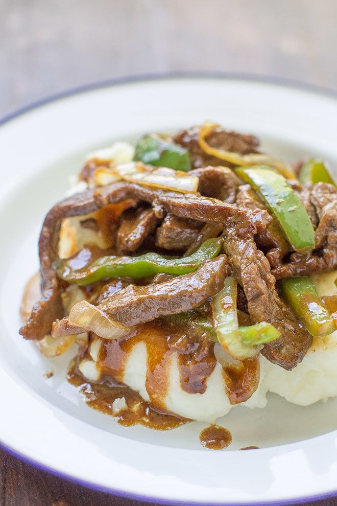 Pepper Steak, updated with a sweet and spicy gravy and served over mashed potatoes, becomes the ultimate comfort food when it's made in the Midwest.