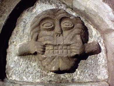 This is one of the finest examples in Ireland of what is known as a 'mouth-puller'.  These carvings were placed at doorways and windows of medieval buildings to scare away intruders and evil spirits.  Dundalk,Ireland