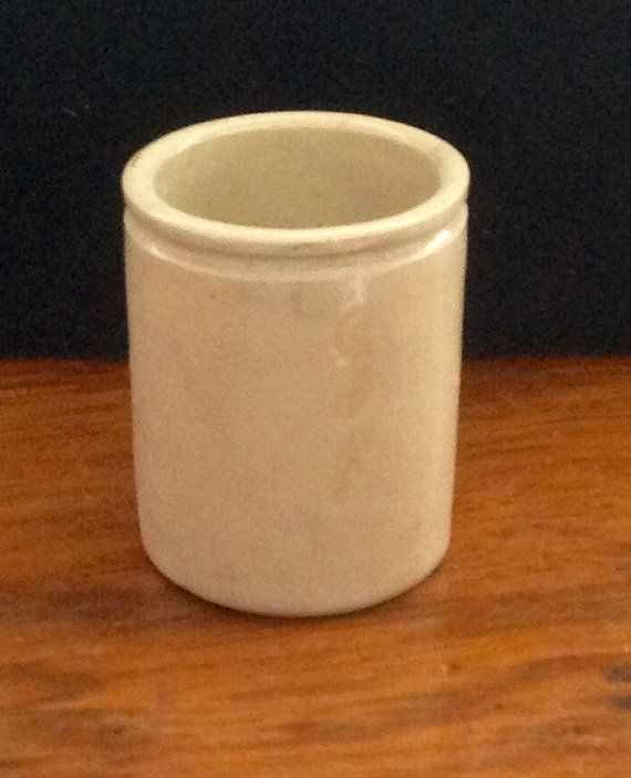 Three antique stoneware pots, one bottle and two more unusual jars.  Large bottle is 6 tall, 2.6 diameter. It has one small chip at the base ( see photo )  The larger jar is 3.2 tall, 2.2 diameter. Good condition.  Smaller jar is 2.2 tall, 1.6 diameter. Good condition.  All three pots have the usual colour changes and marks around them that give them their individual character.  Please note: We are happy to post our vintage items anywhere in the world. As they would be sent tracked and…