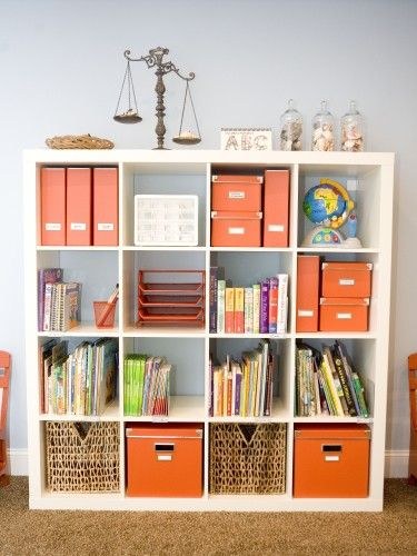 I think I'm on an orange kick!  I like this shorter shelving system, too.  And I love the baskets and binders and filing boxes.  I just like my books and materials neat and orderly and accessible!