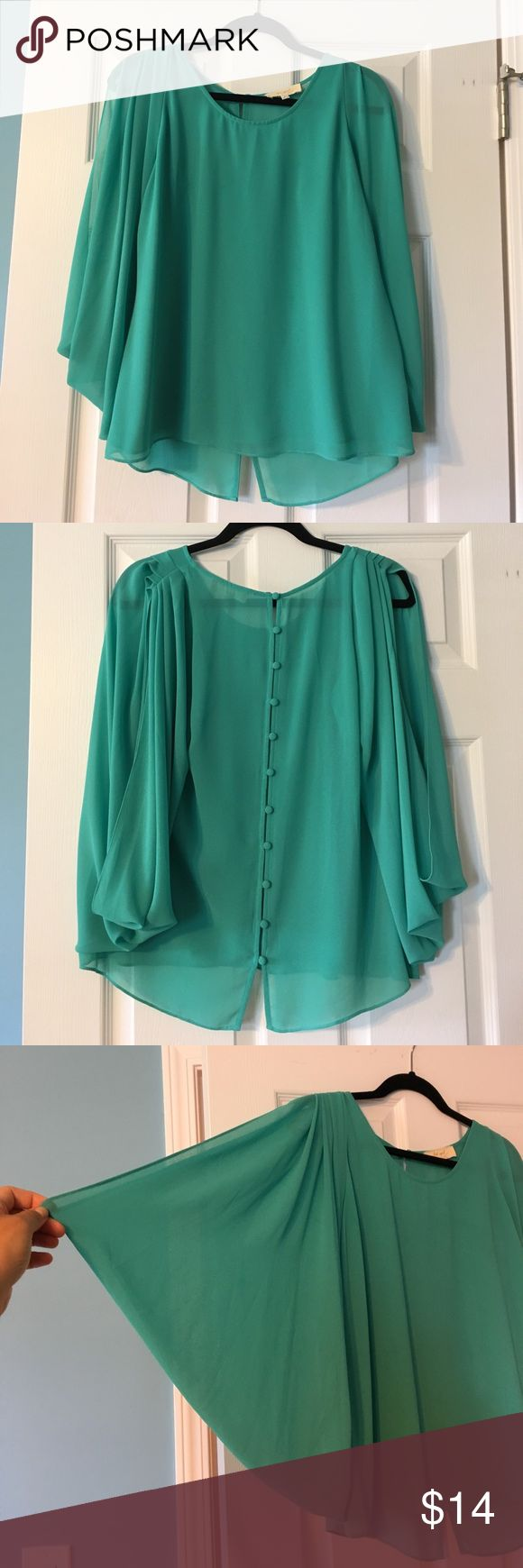 Turquoise blouse Super cute open-sleeve turquoise blouse. Like New; worn two times. No imperfections of any kind. lost april Tops Blouses