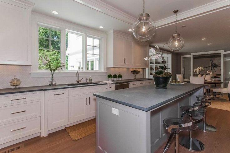 Lovely two-tone kitchen design with white perimeter ...