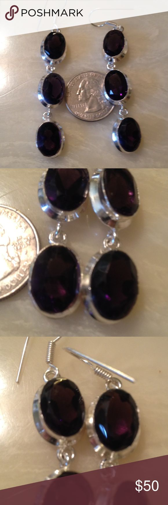 Sterling Silver Amethyst Earrings Gorgeous Sterling Silver Amethyst Earrings. Huge Dark Purple stones. Can see from pics next to quarter how big they are. Dangle style. I am currently offering a Jewelry Gift with Purchase. Buy 3 Jewelry items at listed price and I will include a great pair of Sterling Silver Dark Rainbow topaz earring. Can be seen in last pic. 😻 Jewelry Earrings
