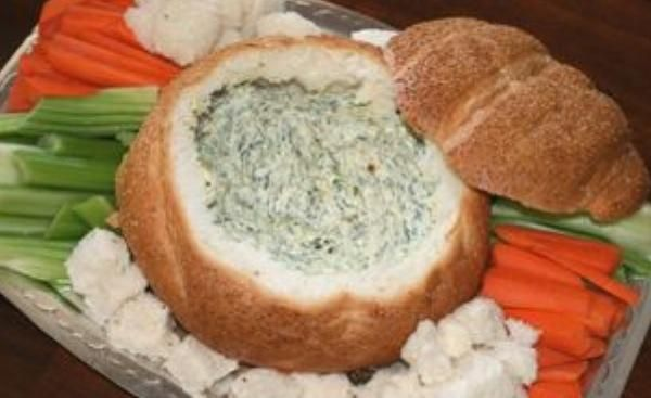 Cobb Loaf Dip: 1 cob loaf 100g grated tasty cheese 300ml sour cream 250g packet Philadelphia cream cheese 1 small bag of baby spinach leaves, 6 spring onions, Salt and pepper Scoop the soft bread out. Combine cheese mixture in the bread casing and cook, uncovered for 1.5-2 hours. During the last 10 minutes, place bread pieces on a tray and bake until crisp. Serve hot with bread and/or raw vegetable pieces for dipping. Add creamed corn for a different flavour.