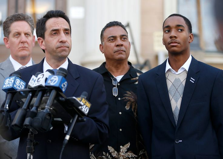 Santa Clara County District Attorney Jeff Rosen, left, talks to the media next to Donald Williams Jr., far right, and Williams' father Donald Williams outside of the Old Courthouse in downtown San Jose, Calif., on Monday, Feb. 22, 2016. (Nhat V. Meyer/Bay Area News Group)