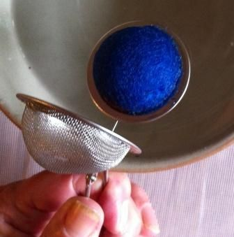 Use tea strainers to make felted balls: Fill strainer with as much wool as possible. Consider mixing different colors. Dip it in warm water and shake vigorously for one minute. Open the ball and drop in a little detergent. Shake again. Reopen strainer and carefully turn the felted ball. Continue to shake the tea strainer in hot water until you get the desired firmness and size. Allow to dry!