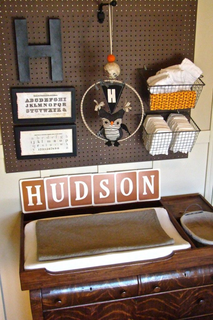 pegboard with baskets for changing table - great idea! Love for a boys room