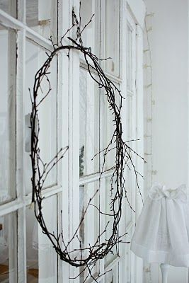 love the simple branches...a few flowers or simple bow?