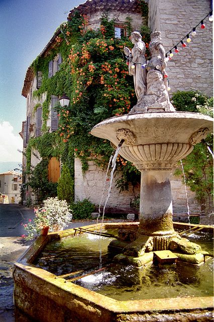 Fountain in Gordes, Provence, France. I want my garden in my yard to look like this!
