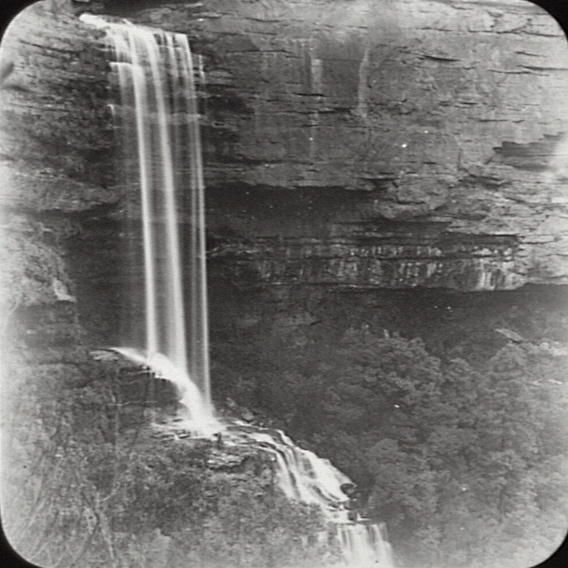 Title: Waterfall, Katoomba Date: Not given Location: Katoomba (NSW) Description: Black and white glass lantern slide. Title in ink on upper edge label. Notes: Unidentified waterfall at Katoomba